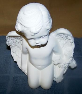 cherub with cross