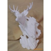 wood carved buck