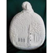 large pumpkin with windows cut out